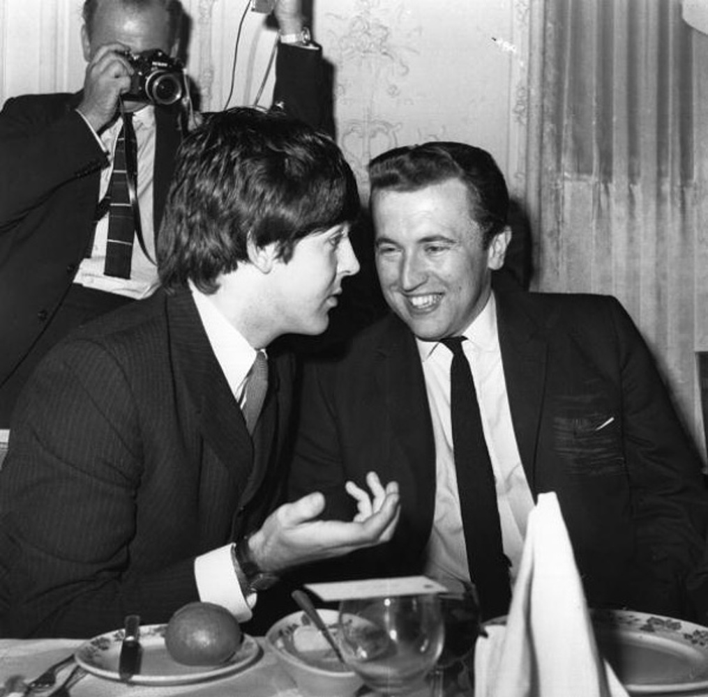 Paul McCartney chats to television presenter David Frost at the Ivor Novello Music Awards Luncheon at the Savoy Hotel, London / 1965